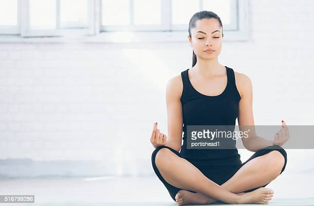 Young asian woman practicing yoga