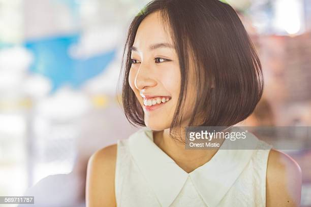 young asian woman relax at cafe