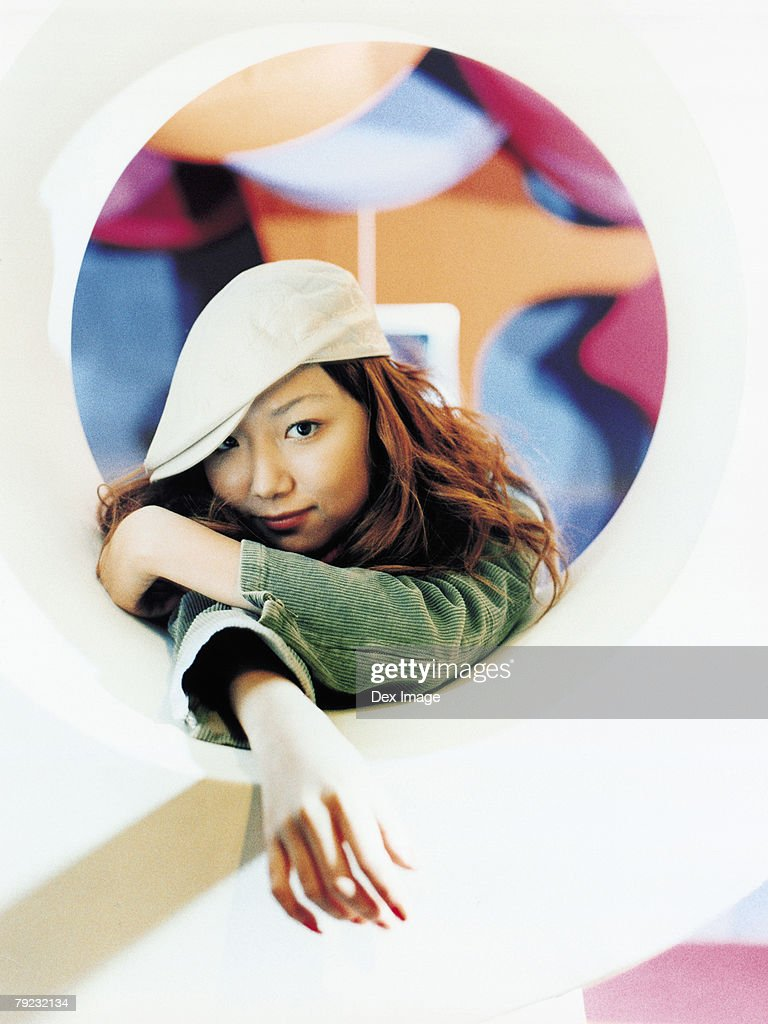 Young Asian woman, round shape window : Stock Photo