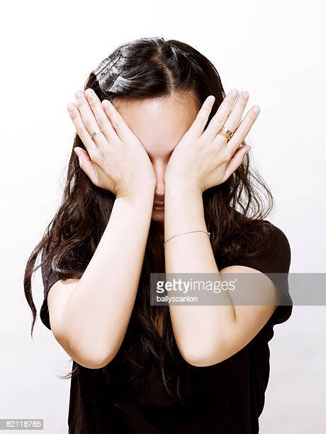 young asian woman rubbing her eyes