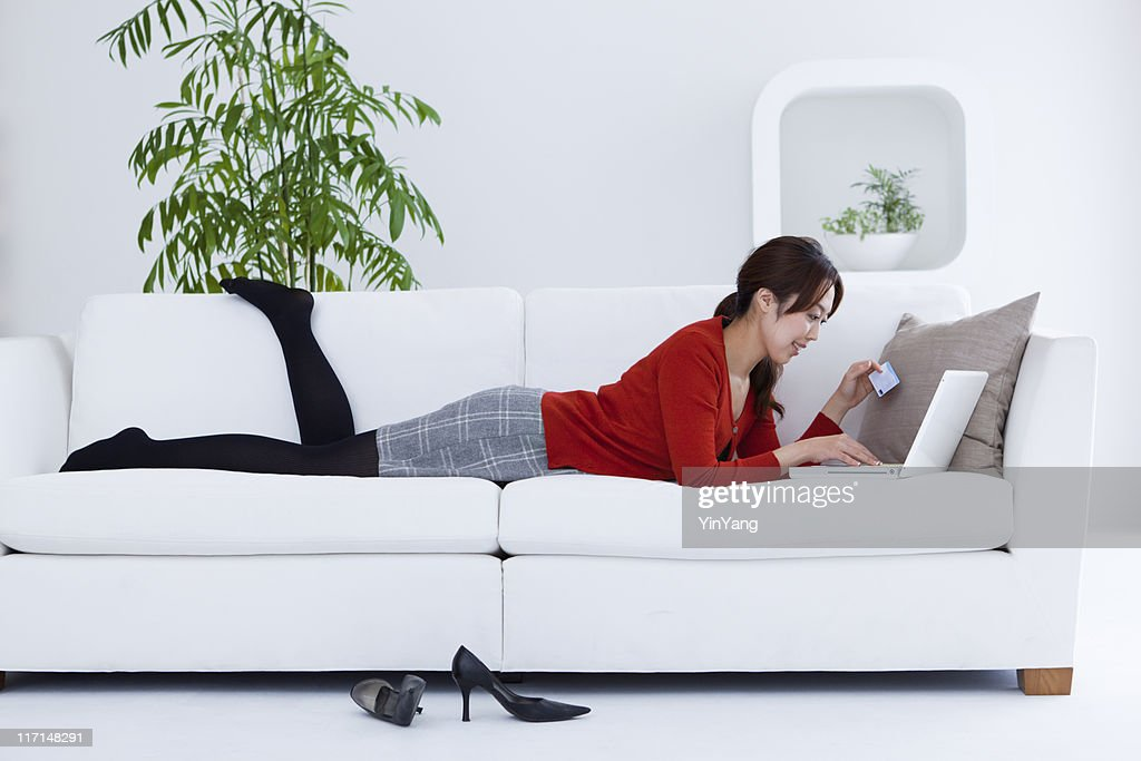 Young Asian Woman Shopping On-line at home with Laptop Computer : Stock Photo