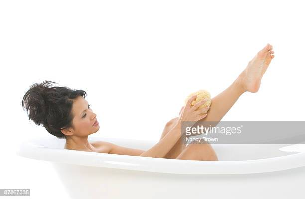 Young Asian Woman taking a bath