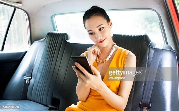 Young Asian Woman Taking Selfies In A Taxi