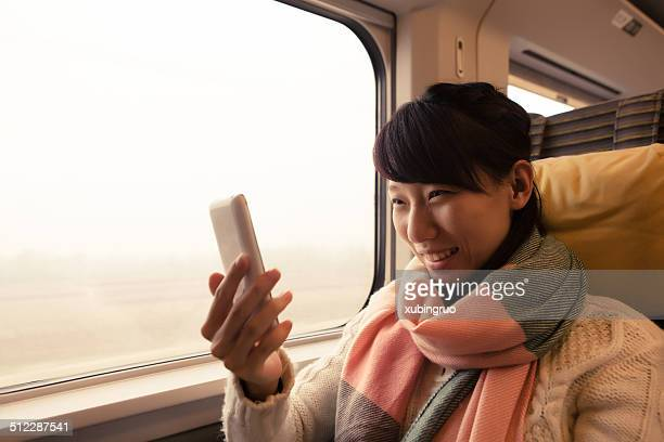 Young Asian Woman Traveling by Train