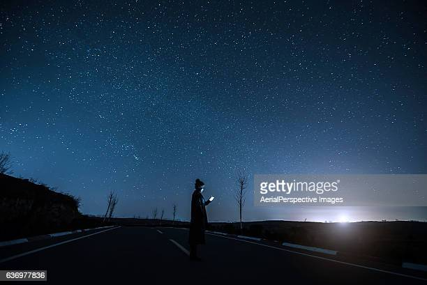 Young Asian Woman Using A Mobile Phone In Starry night