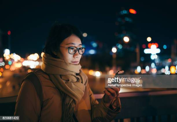Young Asian Woman Using Mobile Phone in Downtown District