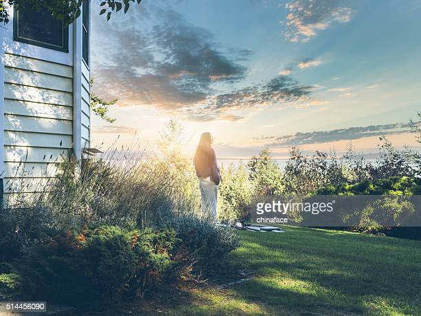 young asian woman watching sunrise