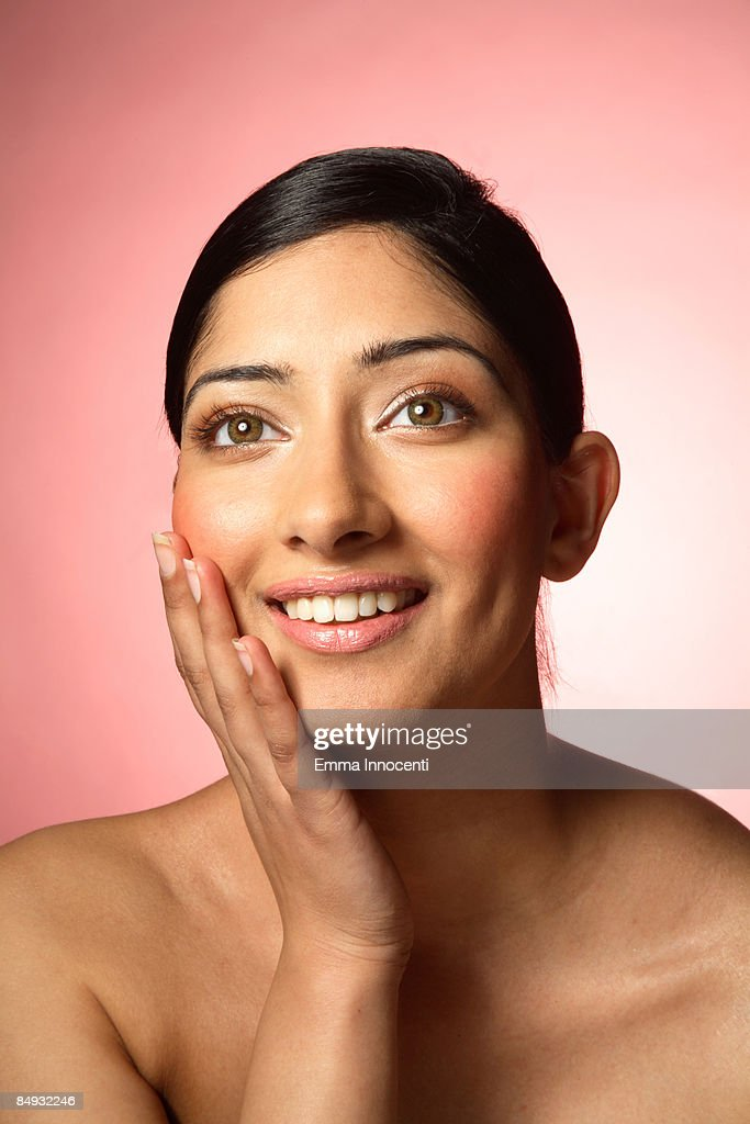 Young Asian woman with hand on chin : Stock Photo