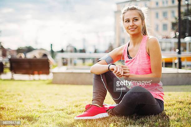Young athlete having a break on a green grass