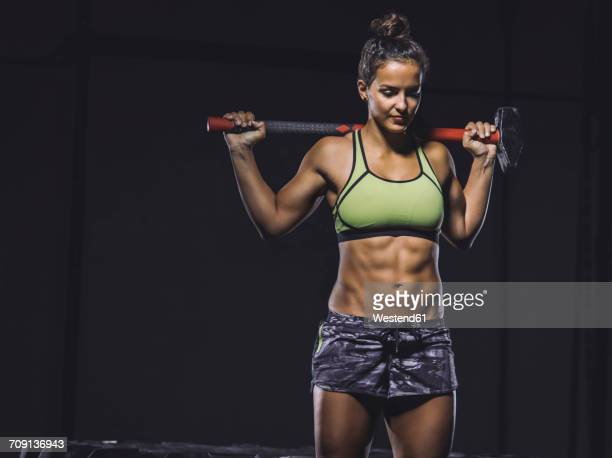Young athlete holding sledgehammer