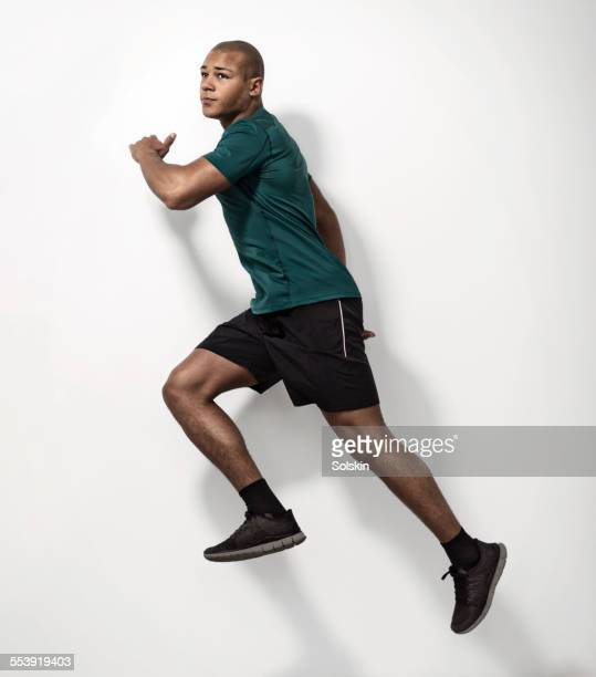 Young athlete man jumping