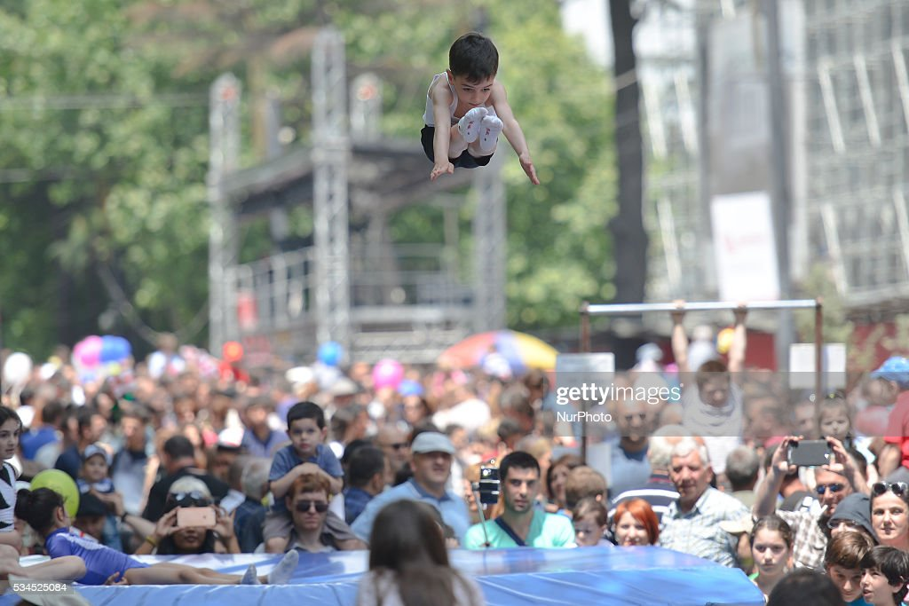 A young athlete shows his skills during a street demonsytation as many people of all age gathered in Tbilisi center for a popular celebrations. Today, Georgia Celebrates its Independence Day commemorating the adoption of the Act of Independence in 1918, that outlined the main principles of the nation's democratic development and formed a first-ever republic under German and British protection, but was then invaded by Bolshevik Russia and absorbed into the Soviet Union. On April 9, 1991, Georgia once again regained its independence. This year Georgia celebrates the 25th Anniversary since the restoration of its independence. Tbilisi, Georgia, on Thursday 26 May 2016.