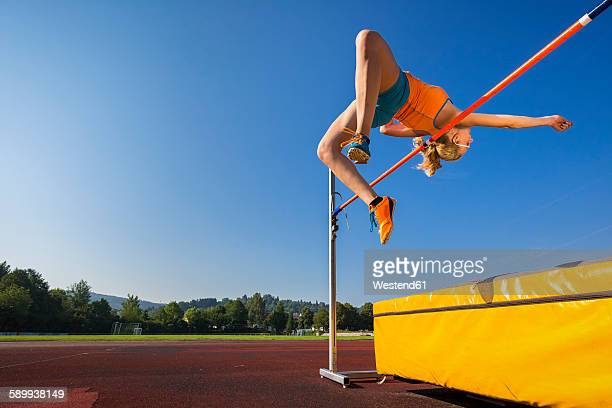 Young athlete training high jump