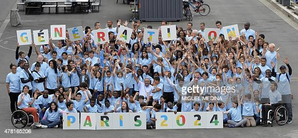 Young athletes and pupils of primary and secondary schools pose on June 23 2015 in Paris during a gathering as part of the official launch for the...