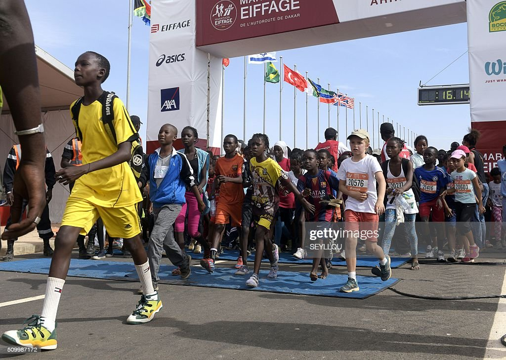 Young athletes compete in the first ever Dakar International Marathon organised by the BTP Eiffage society on February 13, 2016 where thousands of people including numerous teenagers and children, took part in the two-day tournament. The competition started on February 13 in front of International Conference Center Abou Diouf (Cicad) on the outskirts of Dakar with different runs of 10 km and will end the day after, February 14, with a marathon. The BTP Eiffage society hosted the event to celebrates its 90 years of presence in Senegal. / AFP / SEYLLOU