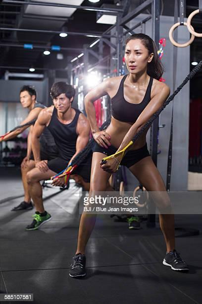 Young athletes exercising at gym