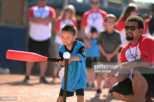 Young Athletes experience the excitement and thrill of participating in softball activities on a worldwide stage through the Toys'R'Us...