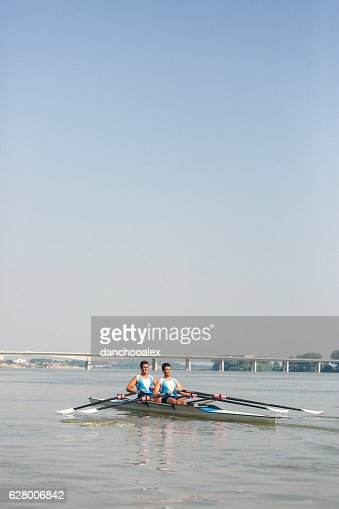 Young athletes rowing on the river