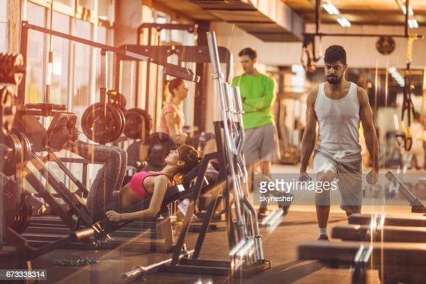 Young athletes working out in a health club.