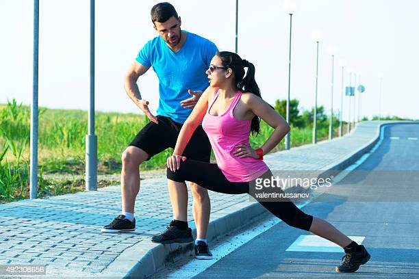 Young athletic couple exercising