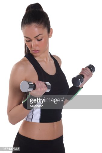 Young athletic woman doing workout : Stock Photo