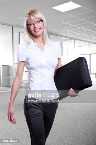 Young attractive business women smiling : Stock Photo