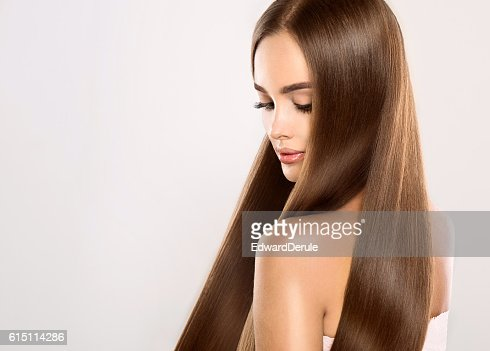Young attractive model with gorgeous, shiny, long, straight hair. : Foto stock