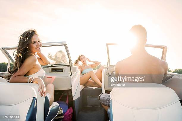 Young attractive people enjoying in a boat ride.