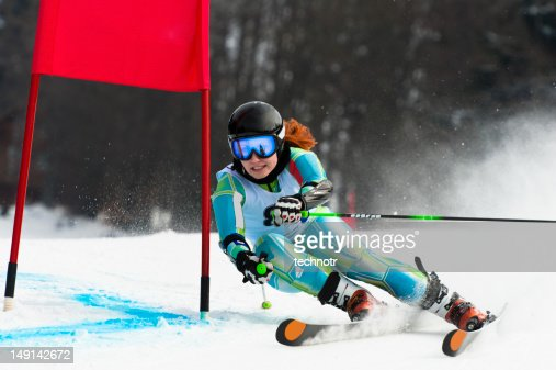 Young attractive woman at giant slalom race : Stock Photo