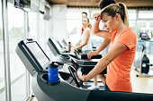 Young attractive woman doing cardio training for weight loss in gym