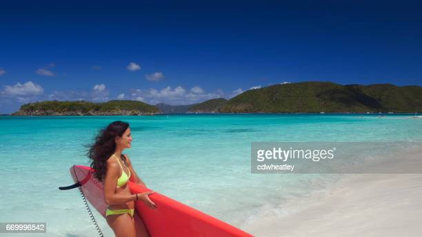 young attractive woman on carrying paddleboard