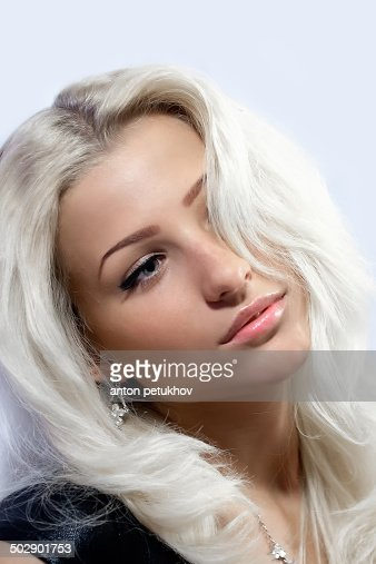 Young attractive woman with a white hair