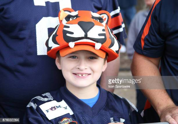 A young Auburn fan awaits the players and coaches for Tiger Walk during a football game between the Auburn Tigers and the LouisianaMonroe Warhawks...