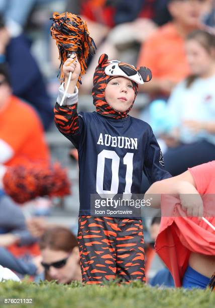 A young Auburn fan cheers on his team during a football game between the Auburn Tigers and the LouisianaMonroe Warhawks Saturday November 18 2017 at...