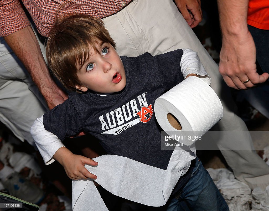 A young Auburn fan gets ready to throw a roll of toilet paper at the Auburn Oaks during the Toomer's Corner Celebration on April 20, 2013 in Auburn, Alabama.