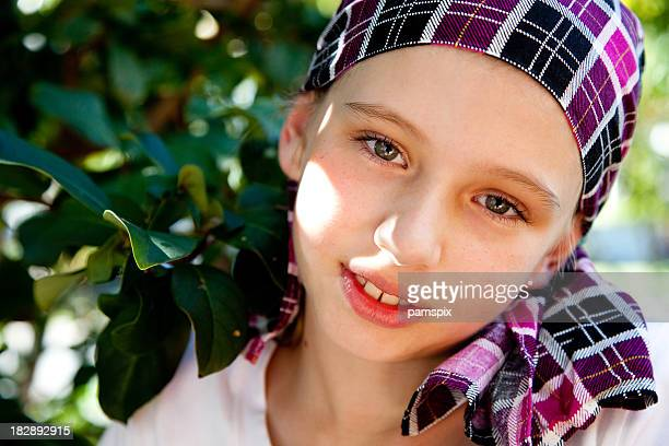 A young Australian girl wearing a plaid bandana