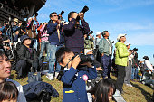 A young aviation fan takes photographs of the prototype Mitsubishi Regional Jet taking off from Nagoya Airport on November 11 2015 in Toyoyama Aichi...