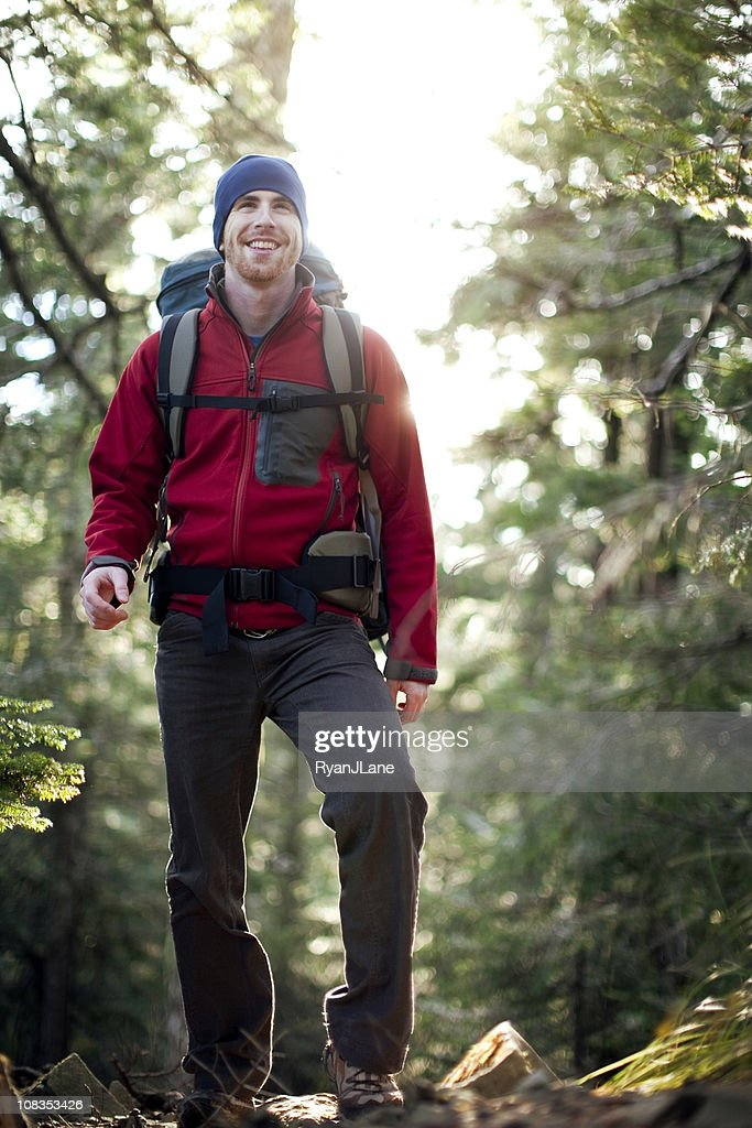 Young Backpacker Hiking in Woods : Stock Photo