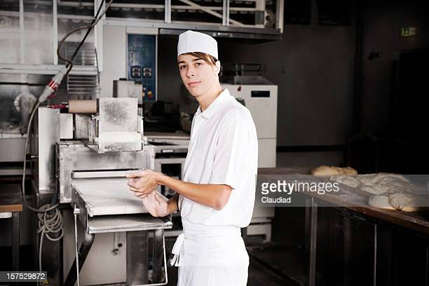 Young baker and machine