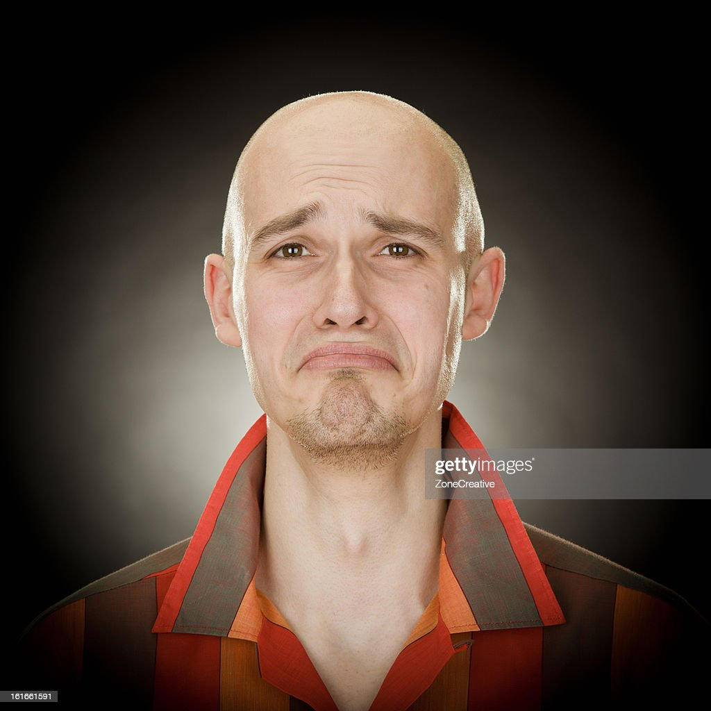 Young bald man, funny sad portrait : Stock Photo