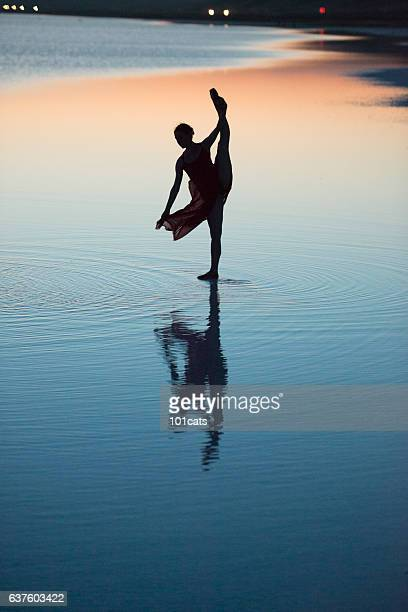 Young ballerina dancing on the salt lake