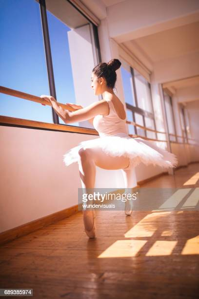 Young ballerina in plie position
