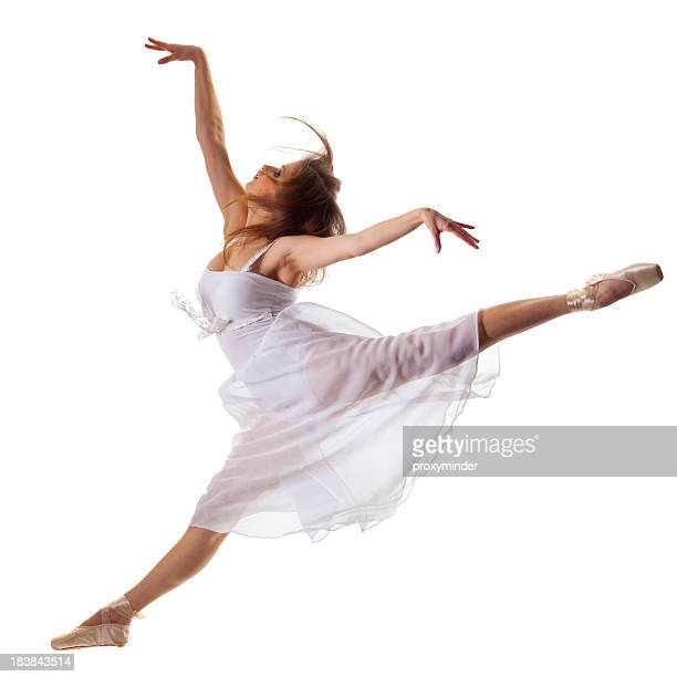 Young ballerina jump in front of white background