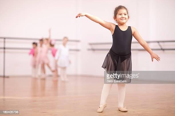 Young ballerina posing in dance studio