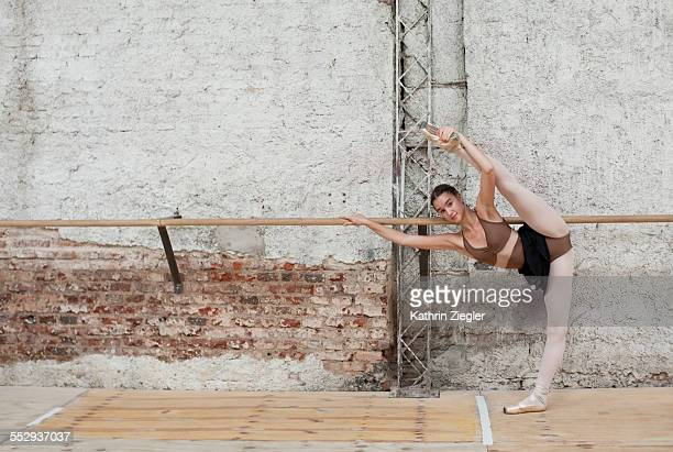 young ballerina warming up at the barre