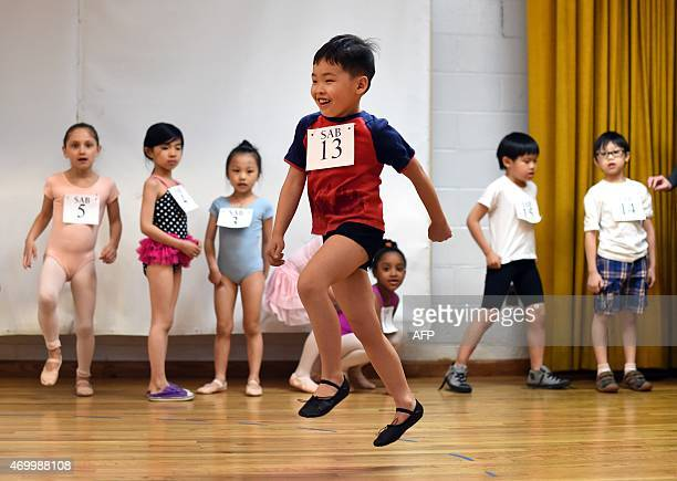 Young ballet dancer Barry Zhang jumps during auditions as boys and girls ages 6 to 7 year old try out for The School of American Ballet Winter Term...