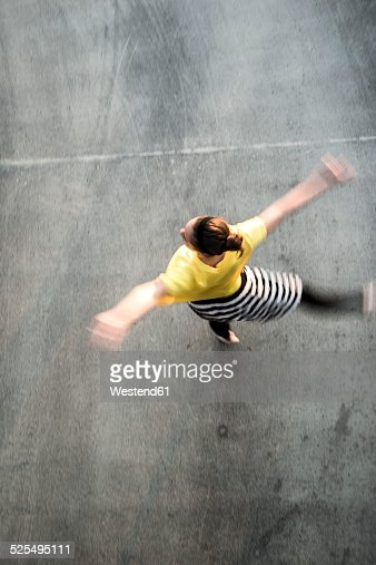 Young ballet dancer exercising on a parking level