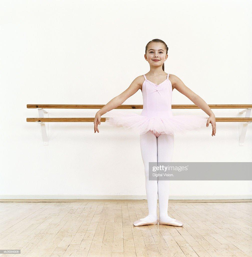 Young Ballet Dancer Practicing in a Dance Studio