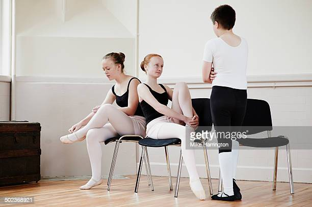 Young ballet dancers conversing at practise.