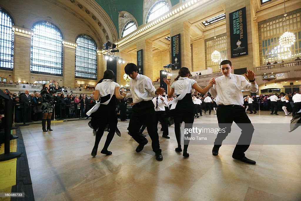 Young ballroom dancers from Dancing Classrooms dance in Grand Central Terminal during centennial celebrations on the day the famed Manhattan transit hub turns 100 years old on February 1, 2013 in New York City. The terminal opened in 1913 and is the world's largest terminal covering 49 acres with 33 miles of track. Each day 700,000 people pass through the terminal where Metro-Noth Railroad operates 700 trains per day.